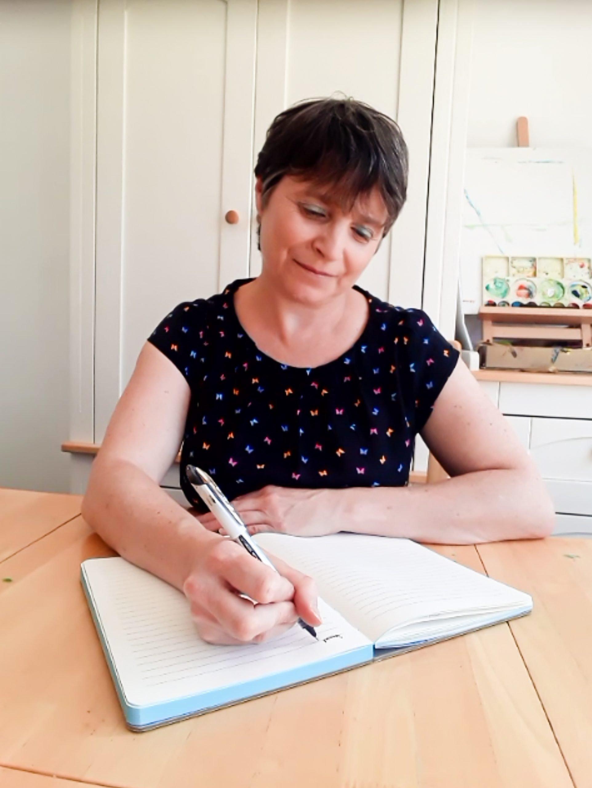 Josie Dom writing a story